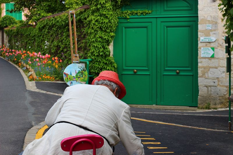 person in front of monet's house in giverny france