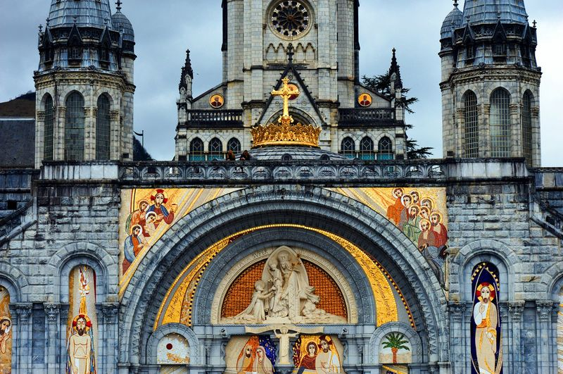 façade of the rosary basilica in lourdes