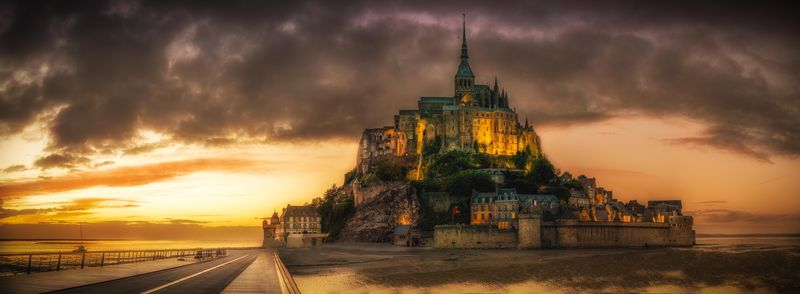 mont saint michel france at dawn