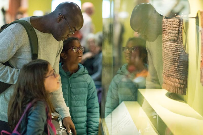 family looking at masterpieces in british museum london