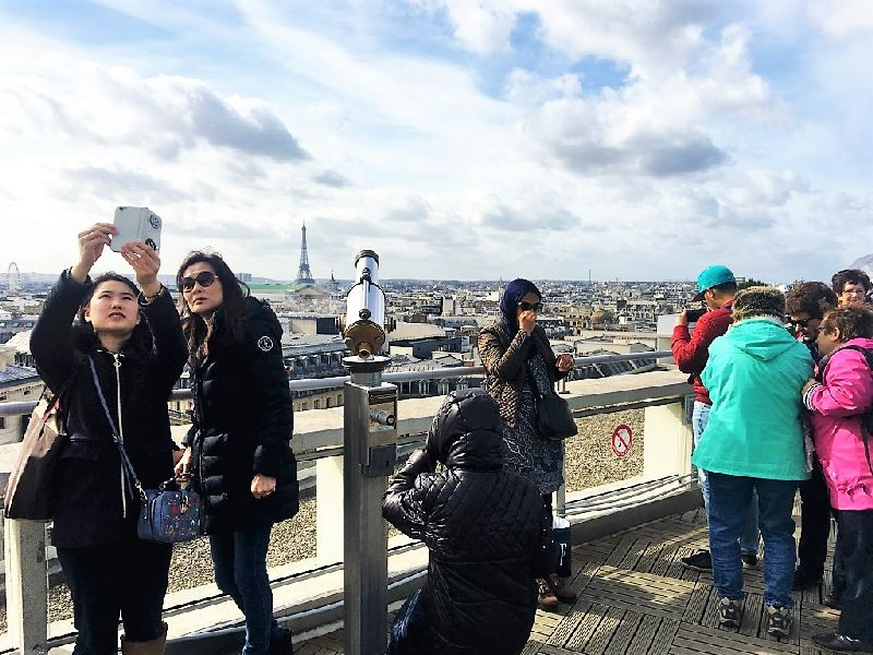 enjoy the view on a rooftop in paris