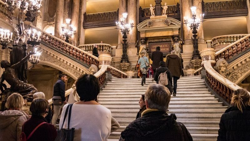 climb the grand stairway in paris opera house with universal tour guide