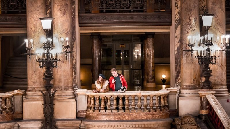 young couple in paris opera house