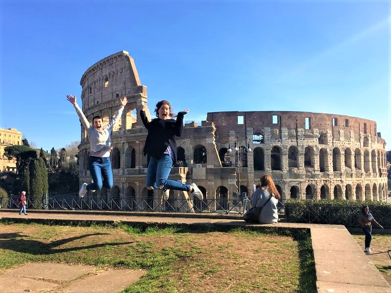 amazing pictures in front of the colosseum rome