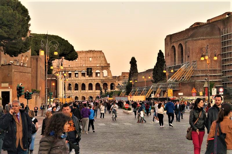 people walking around the colosseum rome