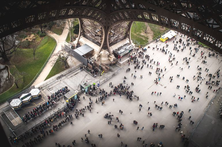 look at people under paris eiffel tower