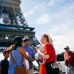 guide making visit with clients at eiffel tower