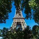 View of eiffel tower from behind trees