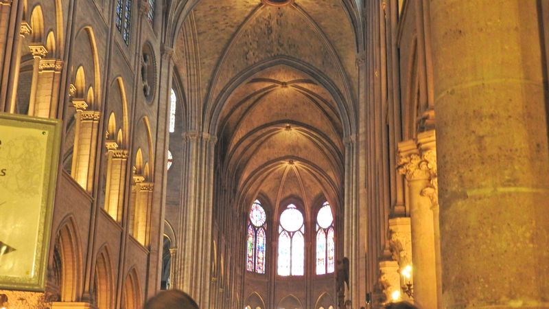 enter cathedral notre dame de paris after french breakfast