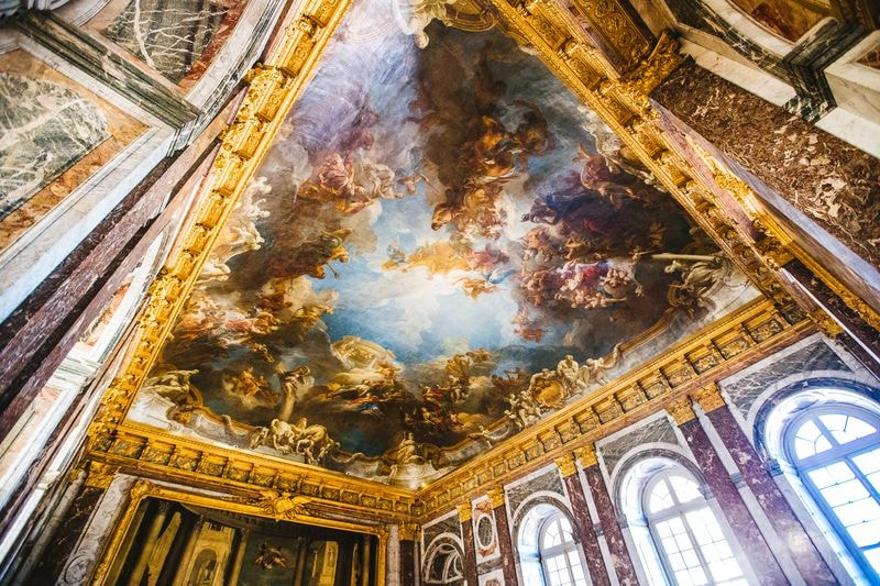ceiling inside the palace of versailles paris